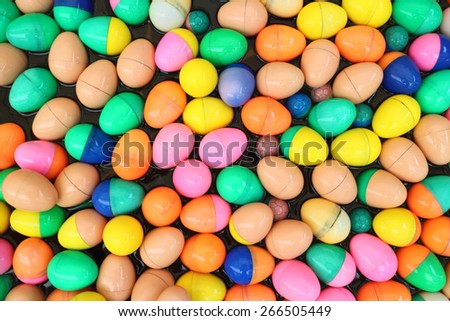 colorful of lucky balls floated in basin egg balls for gamble - stock photo