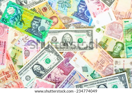 Colorful of many currency for exchange - stock photo