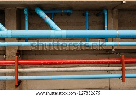colorful of pipe under the modern building. - stock photo
