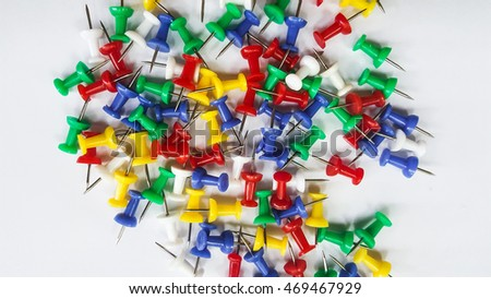 Colorful of push pins on white background isolated.
