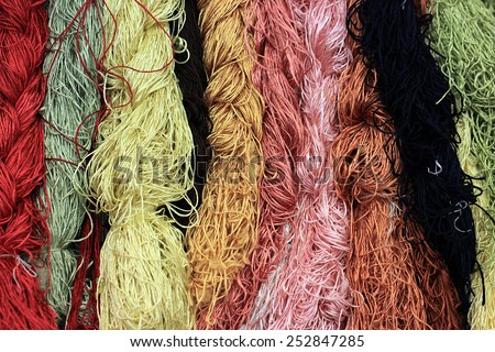 Colorful of Raw silk thread for background. - stock photo