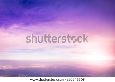 colorful of sky with top view clouds outside the plane. - stock photo