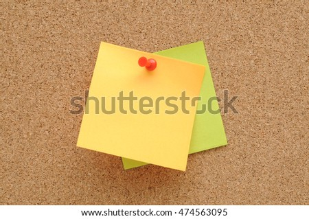 colorful of sticky notes,push pins on cork board