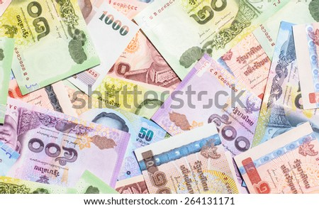 Colorful of Thai currency,banknotes looking forward to business and investing in Thailand - stock photo