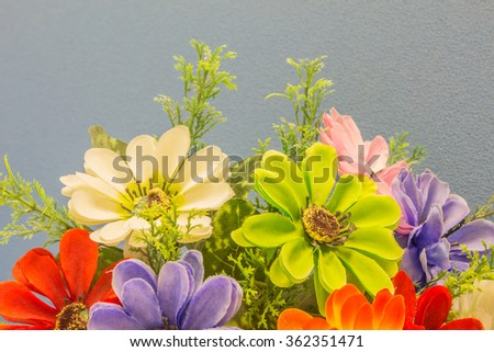 Colorful of the plastic flowers. - stock photo