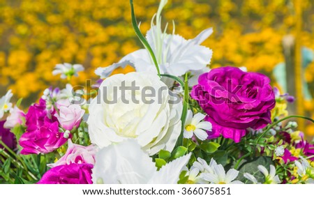 Colorful of the plastic flowers in garden. - stock photo