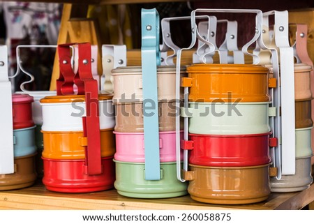 Colorful of tiffin box on shelf for sale.. - stock photo