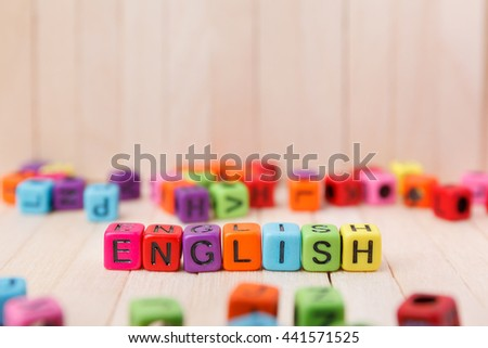 Colorful of word block cube with english text on wooden top table, english language learning concept  - stock photo