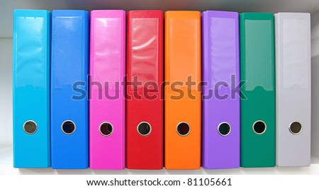 Colorful office folders on the bookshelf