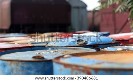 Colorful oil barrels in grunge environment - stock photo