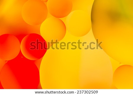 Colorful oil drops on a water surface for background - stock photo