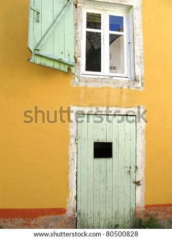 Colorful old farmhouse in France - stock photo