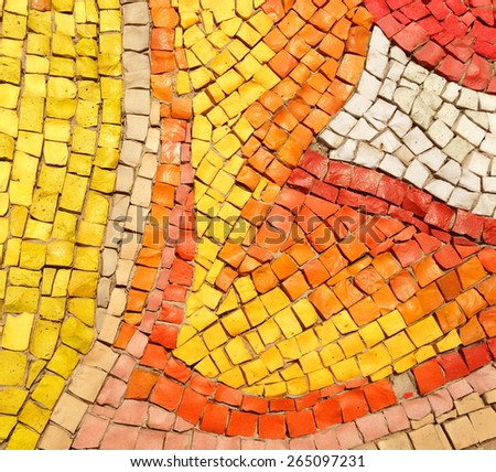 Colorful old stone mosaic on the wall, bright tiles - stock photo