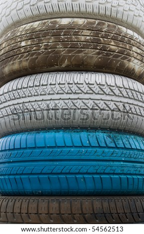 Colorful old tires piled in a stack.