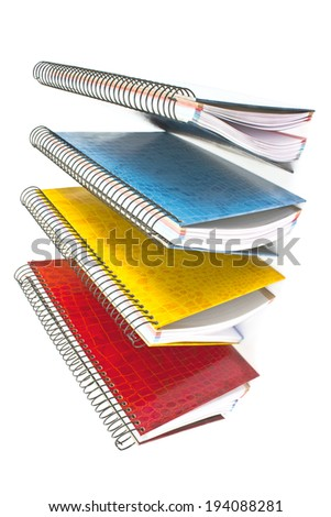 Colorful open spiral notebooks isolated on white