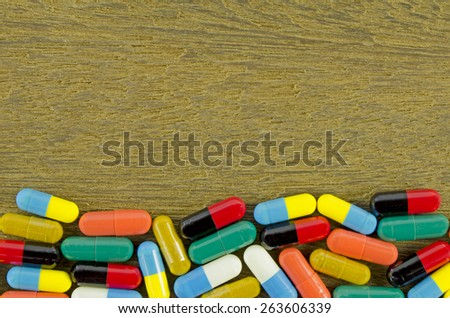 Colorful Oral Medication in Hard Gelatin Capsules. - stock photo