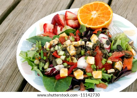 Colorful Organic Salad  with Fresh Fruit for Dessert - stock photo