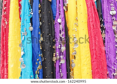 Colorful oriental cloths with metal coins and beads used for belly dancing - stock photo