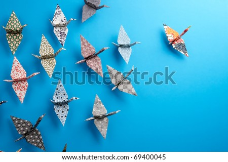 Colorful Origami birds flying to the light. - stock photo