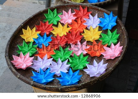 Colorful origami floral on bamboo tray - stock photo