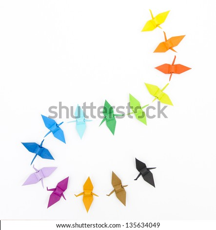 Colorful origami paper cranes on a white background - stock photo