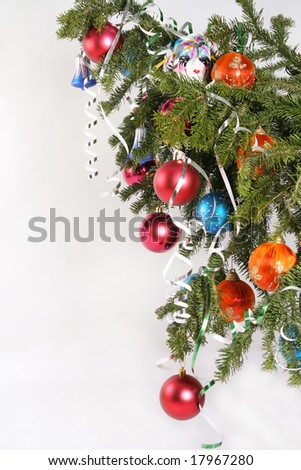 Colorful ornament hanging on Christmas tree - stock photo