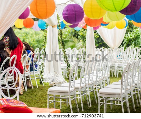 Colorful outdoor lawn tent and garden setting for Indian pre-wedding ceremony. White silk & Colorful Outdoor Lawn Tent Garden Setting Stock Photo 712903741 ...