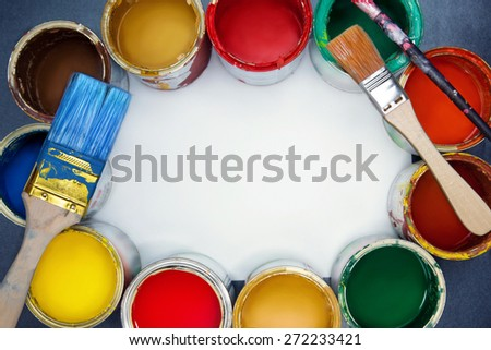 Colorful paint cans, brushes and empty space for note. - stock photo