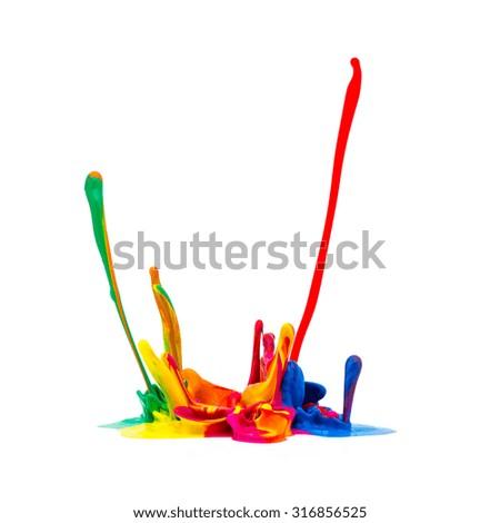 Colorful paint splashing on white - stock photo