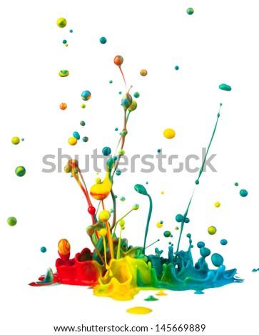 Colorful paint splashing on white background - stock photo