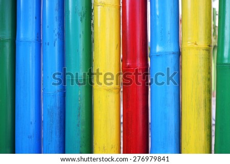 colorful painted bamboo as background.