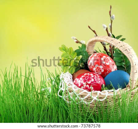 Colorful painted easter eggs in basket - stock photo