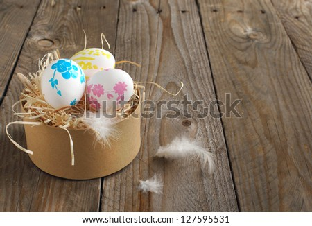 Colorful painted easter eggs in brown paper box - stock photo