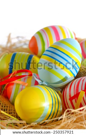 Colorful painted easter eggs isolated in basket - stock photo