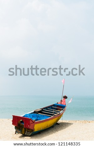 Colorful painted fishing boat on beach in India - stock photo
