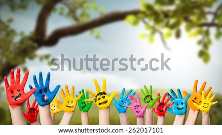 colorful painted hands in front of a spring scene