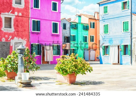Colorful painted houses in Burano, Venice Italy. - stock photo