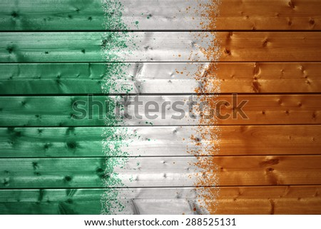 colorful painted irish flag on a wooden texture - stock photo