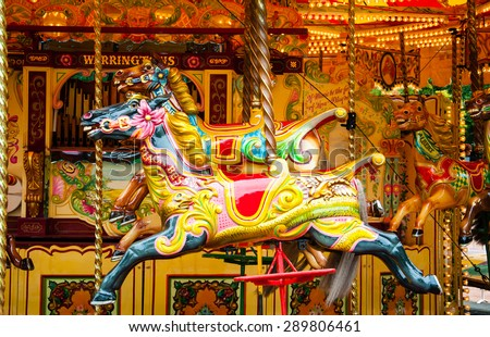 colorful painted ponies on a merry-go-round - stock photo