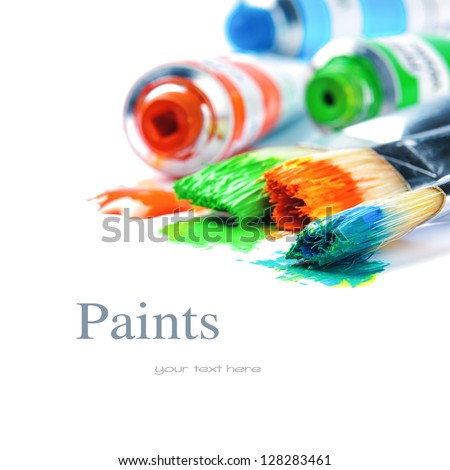 Colorful paints and artist brushes isolated over white - stock photo