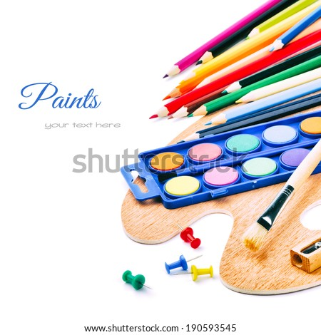 Colorful paints and crayons isolated on white background  - stock photo