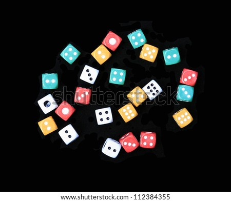 Colorful pairs of gaming/gambling dice isolated on a black background - stock photo