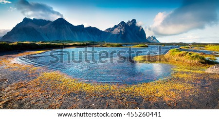 Colorful panorama of the Stokksnes headland on southeastern Icelandic coast. Iceland, Europe. Artistic style post processed photo.