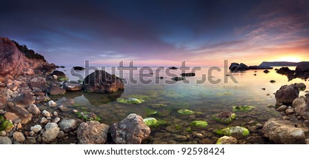Colorful panorama of the sunset on the sea - stock photo