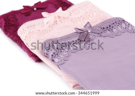 Colorful panties  on white background. - stock photo