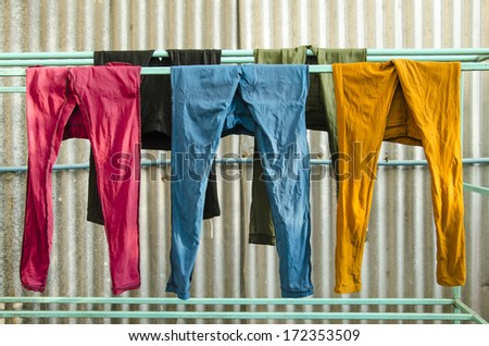 Colorful pants on a clothesline to dry - stock photo