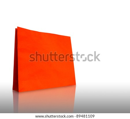 Colorful paper bag ready for shopping, with reflect