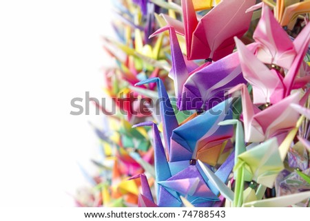 Colorful paper birds hanging together using fishing lines. Shallow depth of field. - stock photo