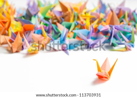Colorful paper birds on white background. - stock photo
