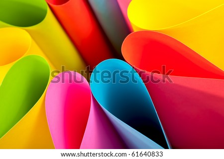 Colorful paper card stock abstract in elliptical shapes. - stock photo